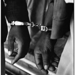 Ernest Cole, Handcuffed blacks were arrested for being in white area illegally. From House of Bondage Period: 1960-1966 © The Ernest Cole Family Trust Courtesy of the Hasselblad Foundation, Gothenburg, Sweden