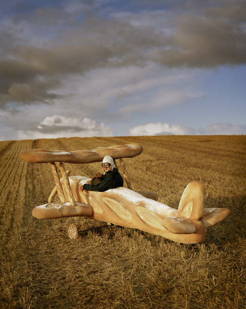 Tim Walker - Rollo Hesketh-Harvey and his baguette biplane Eglingham Hall, Northumberland, 2009