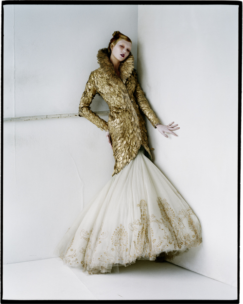 Tim Walker - Karlie Kloss in gold feathers, Fashion: Alexander McQueen, Sjhoreditch London, 2010