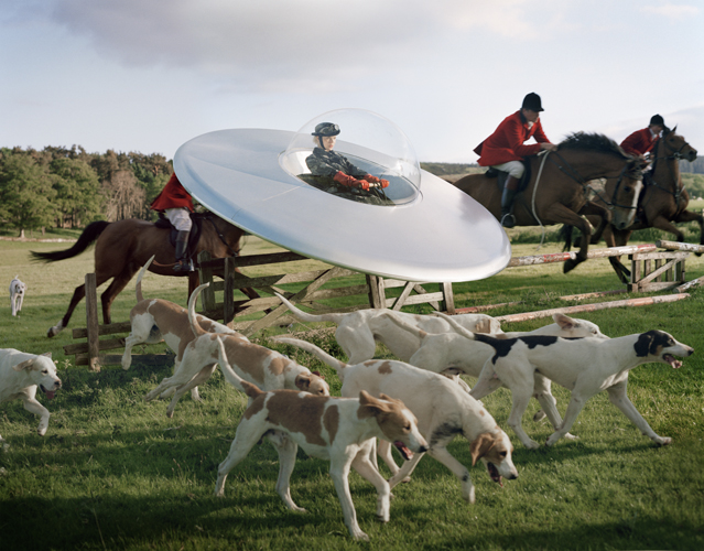 Tim Walker - KingaRajzak in flying saucer with members of West Percy Hunt Fashion:Prada, Eglingham Hall, 2009