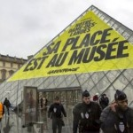 Greenpeace occupy Louvre
