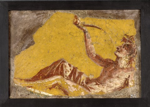 Fragment of a wall painting showing a man reclining to drink. Da Pompei, I sec. - Copyright the Trustees of the British Museum