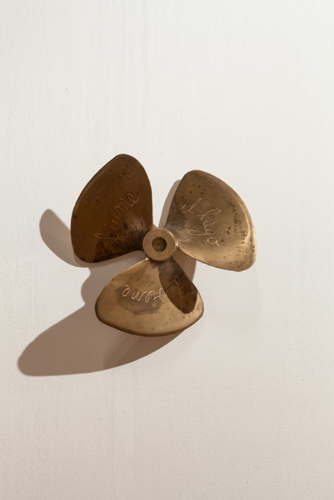 Giovanni Ozzola, Propeller. L'Eterno Ritorno, 2013 - brass, hand written texts - ø 50 x 10 cm Courtesy the artist and Galleria Continua - Photo Gustavo Rugeles G.