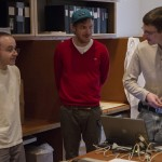 Cory Arcangel (Center), and CMU Computer Club members Michael Dille (Left), Keith A. Bare (Right) during the data recovery process at The Andy Warhol Museum. Photo- Hillman Photography Initiative, Carnegie Museum of Art
