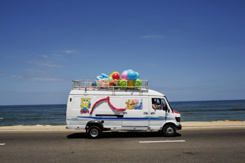 A toy store van drives along Gaza's beach high way.