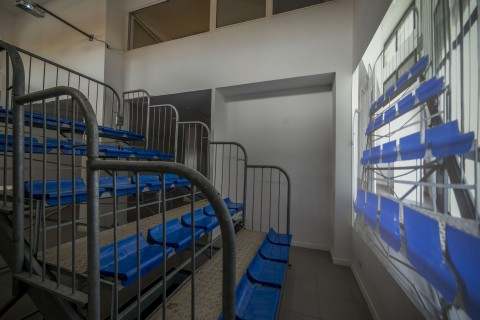 Ilona Németh, Grand Stand III, Greetings from Rome for Bruce Nauman, 2014, metal and plastic seats + slide projection, variable dimension, Architect: Marián Ravasz, photo by Giorgio Benni, courtesy The Gallery Apart, Rome