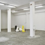 Installation view of Naum 2014, plaster, clay, paraffin, styrofoam, ceramic, latex, bucket barrels, water pump, electric cables