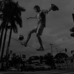 BRAZIL. Sao Paulo. July 11, 2014. Jalison Nougueira, 22, who earns money by performing everyday on Rua dos Estados Unido at the corner of Aenida 9th Julho. He's been training as a freestyle footballer on a tight-rope since he was 11 ye