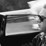 Steve McQueen driving his XK-SS Jaguar through Nichols Canyon in Hollywood in 1960 - © Sid Avery : mptvimages.com