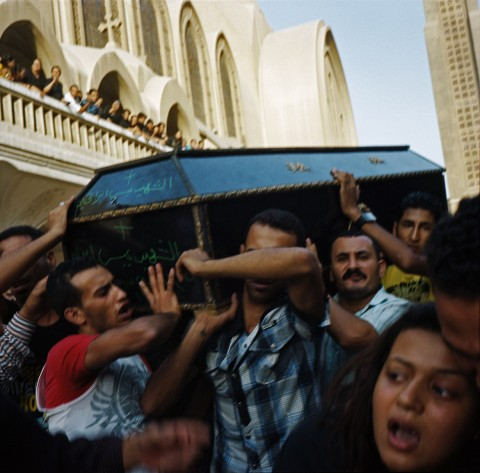 Rena Effendi, Relatives of coptic victims carrying coffins out of the Abasseya Church to be burried. October 10, 2011
