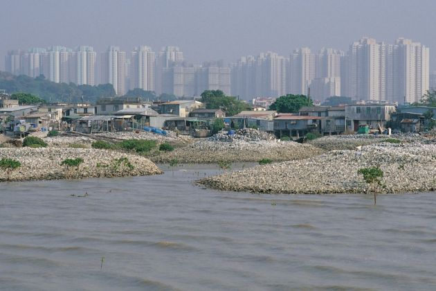 Uneven Growth (Mak) – Lau Fan Chan-oyster farm in front of Tin Shui Wai New Town, Hong Kong, 2014 ©MAP Office