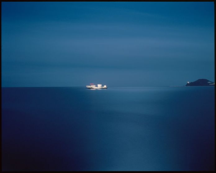 Giovanni Scotti, Isolated boat transiting for 35 minutes into the deepest blue for the purpose of viewing beyond the limits of visibility, 2013