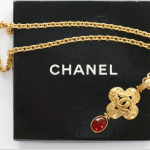 A Chanel gilt metal pendant necklace, 1996