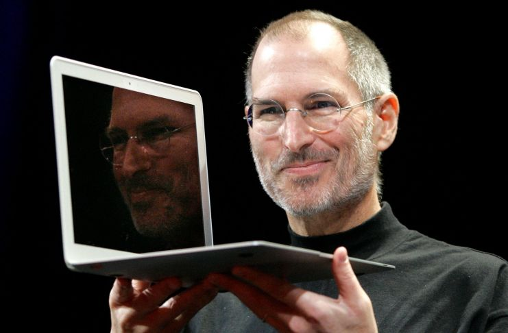 Apple CEO Steve Jobs holds up the new MacBook Air after giving the keynote address at the Apple MacWorld Conference in San Francisco, Tuesday, Jan. 15, 2008. The super-slim new laptop is less than an inch thick and turns on the moment it's opened. (AP Photo/Jeff Chiu)