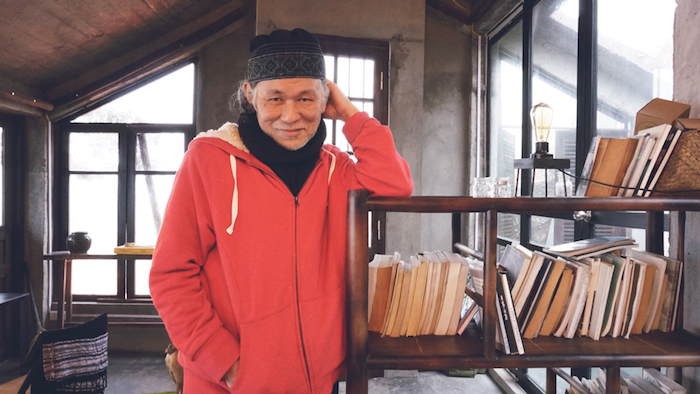 Award winning writer Nguyen Qui Duc at his home in Vietnam. Courtesy of VAWAA