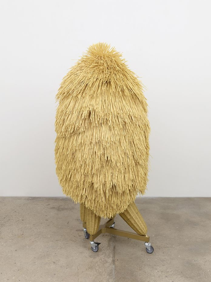 Haegue Yang The Intermediate – Asymmetric Quadrupedal Bushy-head 2016 Artificial straw, steel stand, powder coating, casters. Courtesy of the artist and Greene Naftali, New York