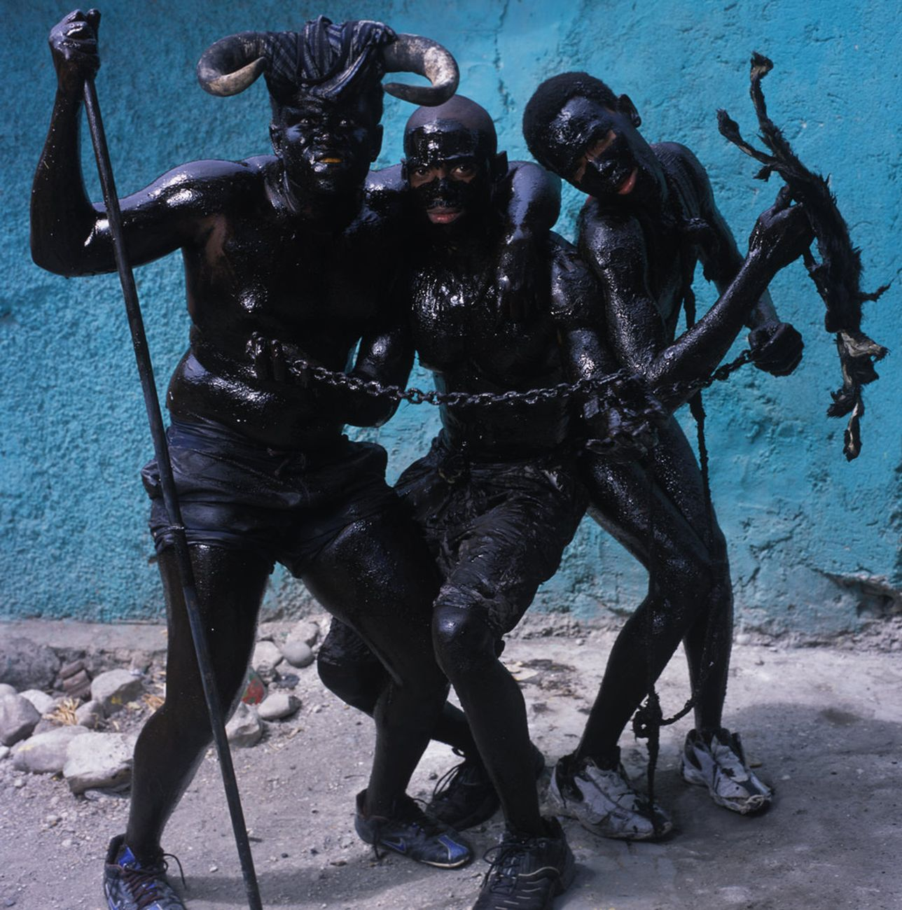 Phyllis Galembo, Three Men With Chains, 2004. Courtesy Sindika Dokolo Foundation, Bruxelles