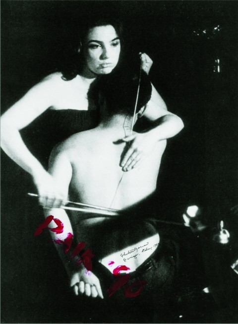 """Nam June Paik e Charlotte Moorman, Human Cello. John Cage's """"26'1.1499"""" for a String Player 1965, Performance realised at Café au Go Go, New York, 1965, © photo by P. Moore, Edited by Pari Editori & Dispari, Cavriago, 1984"""