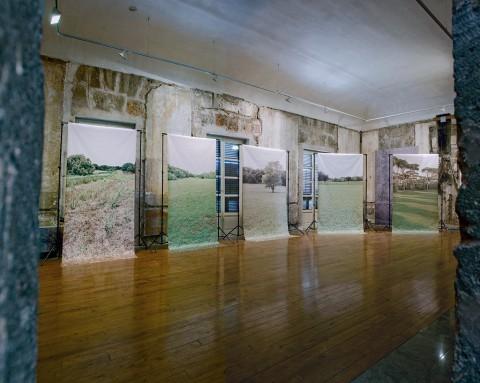 Sergio Zavattieri, From the background to the foreground, 2013, stampe inkjet su vinile, supporti per fondali fotografici neri, tubi in pvc, n. 5 270x250x200 cm