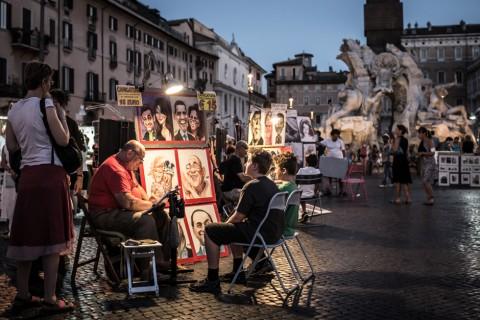 Caricaturisti a lavoro in Piazza Navona