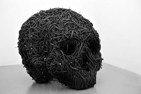Paolo Grassino, Ciò che resta, 2013, tubo corrugato in forassite e ferro
