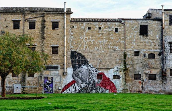 Palermo, Piazza Magione con un murale di Sten Lex
