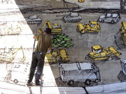 Blu a lavoro sul nuovo murale di Chiomonte