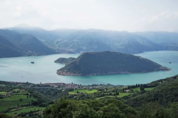 The Floating Piers - Lake Iseo with the town of Sulzano in the foreground, the island of Monte Isola in the center and the island of San Paolo on the left