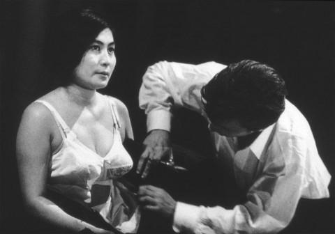 Yoko Ono, Cut Piece, 1964 - performed by Yoko Ono, Carnegie Recital Hall, New York, March 21, 1965 – photo Minoru Niizuma - courtesy Lenono Photo Archive, New York