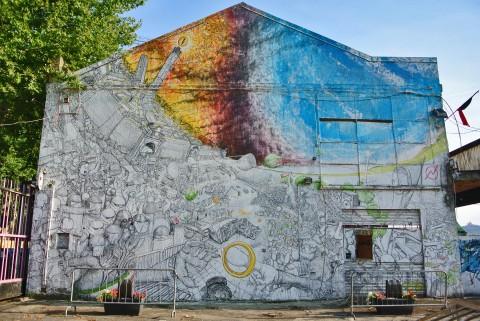 Il murale di Blu per il Cso Xm24, a Bologna