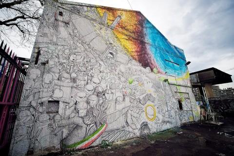 Il murale di Blu per il Cso Xm24, a Bologna - foto by streetartnews