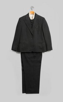 Emsley. Suit (Jacket, Pants, and Vest), 1983. Black wool. Inner garment: Lord & Taylor. Shirt, circa 1960s. White cotton. Georgia O'Keeffe Museum, Santa Fe, N.M.; Gift of Juan and Anna Marie Hamilton, ph. © Gavin Ashworth