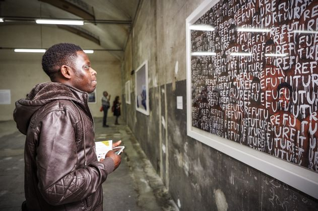 Liu Bolin. Migrants. Exhibition view at Cantieri Culturali alla Zisa, Palermo 2017