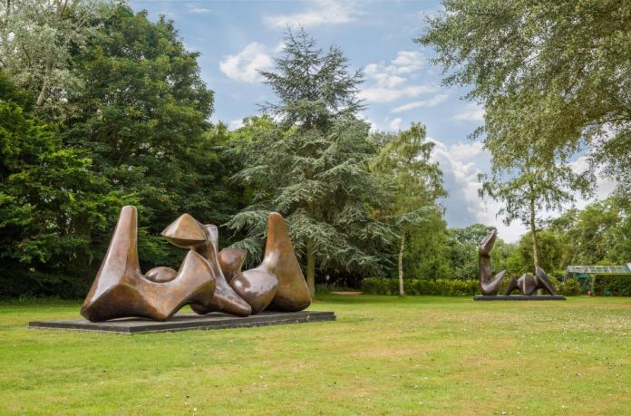 Henry Moore, Three Piece Sculpture, Vertebrae, 1968-69 and Two Piece Recicling Figure, Cut, 1979-81, on display in the gorunds, ph. Sarah Mercer, courtesy Henry Moore Foundation