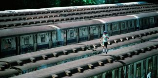 Boy Running on Top of Train, CC Yard, Bronx, NY, 1983 ©Martha Cooper