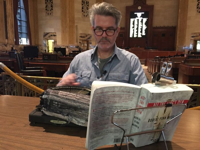 Tim Youd retyping Robert Penn Warren's All the King's Men. Louisiana State Capitol with The New Orleans Museum of Art, Baton Rouge, LA, January 2016. Courtesy the artist and Cristin Tierney Gallery