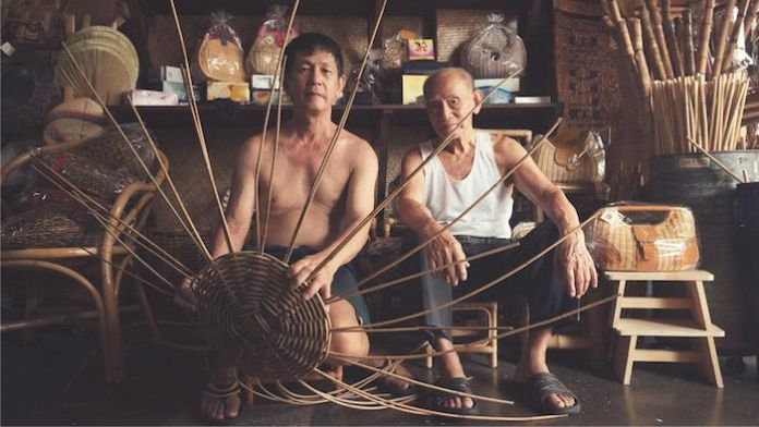 Rattan weaver Sim Chew Poh (left) and with his father, master weaver Sim Buck Teik. Courtesy of VAWAA