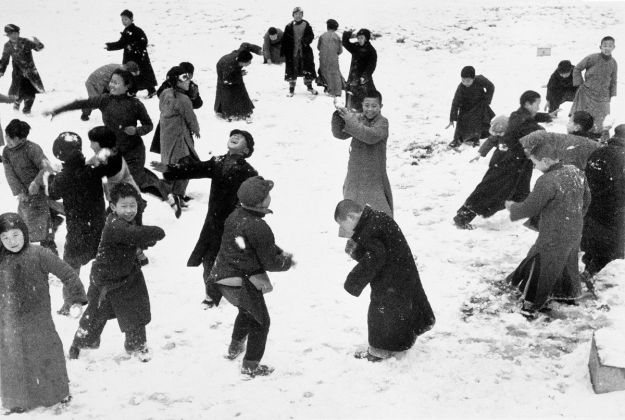 Robert Capa, China. Hankou. March, 1938. Children playing in the snow.