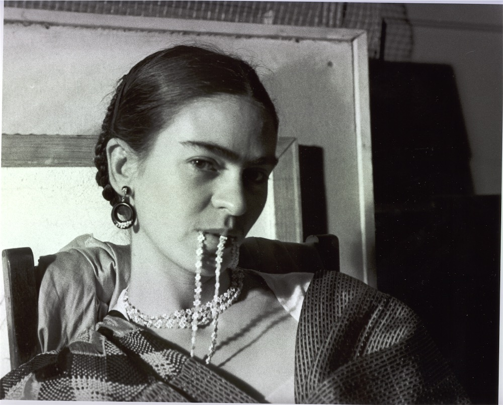 Frida Biting Her Necklace New Workers School. Photo ©Lucienne Bloch
