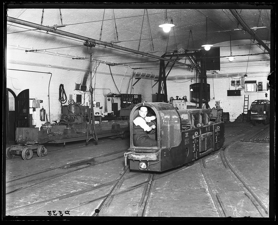 Post Office underground railway - man operating a shunting vehicle, 1935