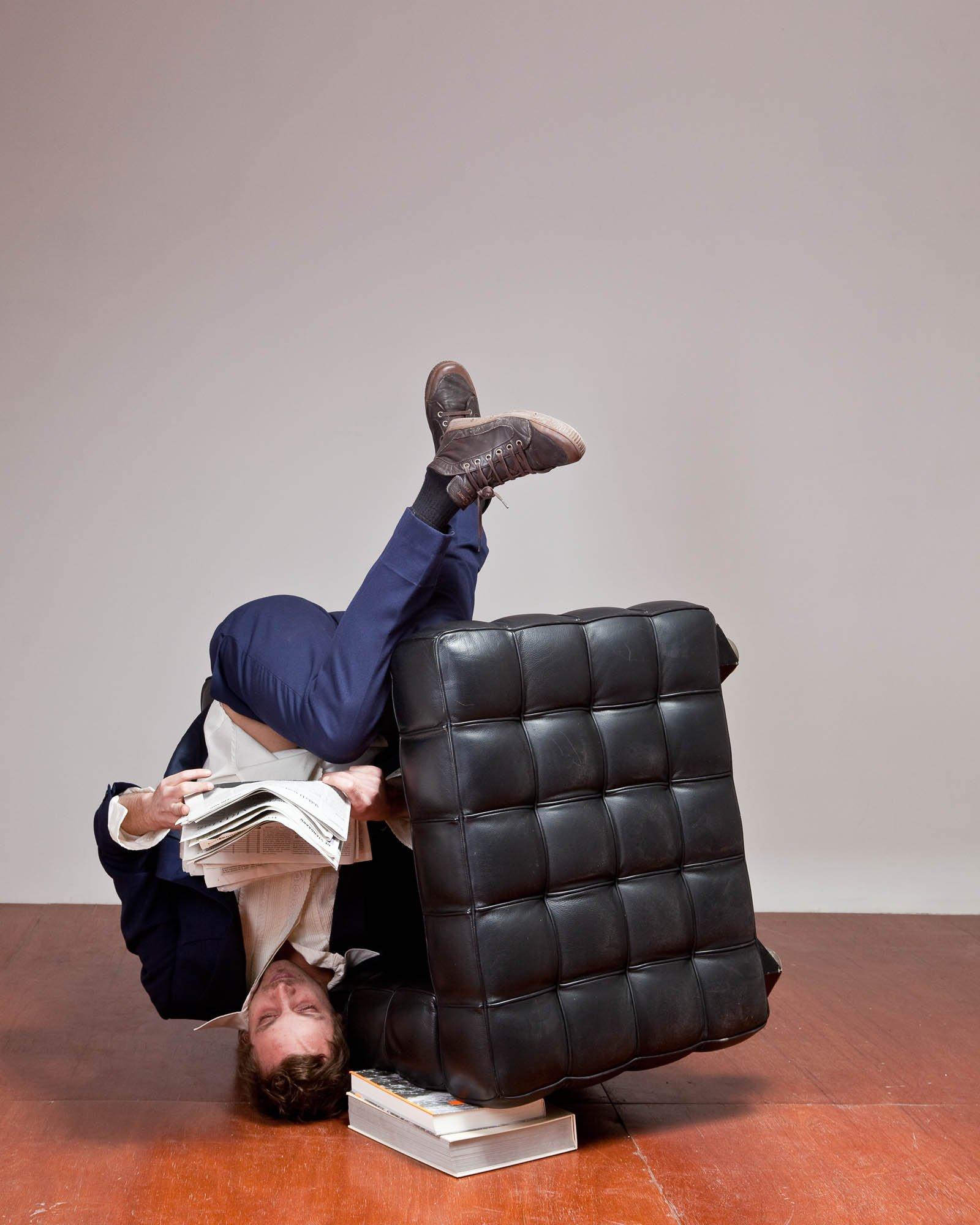 Seeking comfort in an uncomfortable chair. Photo Kristof Vrancken, performer Seppe Baeyens. Courtesy Z33, Hasselt