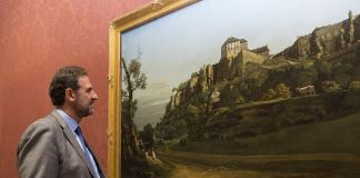 National Gallery Director, Dr Gabriele Finaldi looks at the Bellotto (c) National Gallery, London