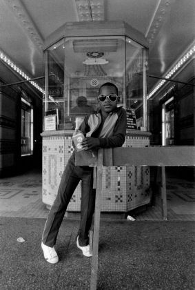 Dawoud Bey, A Boy in Front of the Loew's 125th Street Movie Theater, 1976 (printed 1979). Gelatin silver print, 230 x 150 mm. © Dawoud Bey. Courtesy of Stephen Daiter Gallery.
