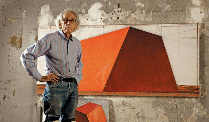 Christo in his studio with a preparatory drawing for The Mastaba, New York City, 2012. Photo Wolfgang Volz