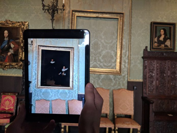 One of the Isabella Stewart Gardner Museum paintings stolen in 1990, Rembrandt van Rijn's A Lady and Gentleman in Black, returned to its frame through the magic of augmented reality. Photo courtesy of the Cuseum.