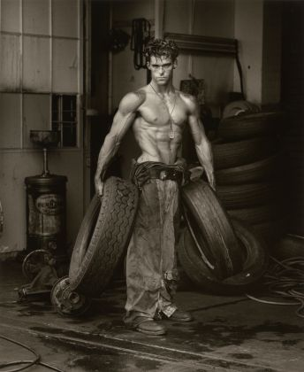 Herb Ritts, Fred with Tires, Hollywood [Body Shop series], 1984, Copyright © Herb Ritts Foundation, Object Credit The J. Paul Getty Museum, Los Angeles, Gift of Herb Ritts Foundation