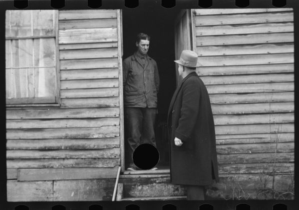 Theodor Jung Untitled photo, possibly related to: Resettlement Administration representative at door of rehabilitation client's house, Jackson County, Ohio April 1936 Digital print from scanned 35mm b&w negative Courtesy line