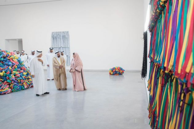 HH Sheikh Dr Sultan bin Mohammed Al Qasimi, Member of the Supreme Council, Ruler of Sharjah and Sharjah Art Foundation President Sheikha Hoor Al Qasimi touring Hassan Sharif, I Am The Single Work Artist, 2017, Image courtesy of Sharjah Media