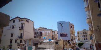 Ballarò, il murale di Andrea Buglisi tra vecchie case