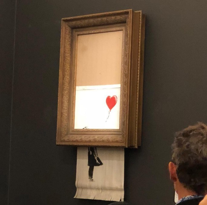 Girl with Balloondi Banksy distrutta durante l'asta di Sotheby's